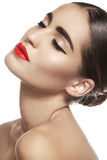 Luxury brunette woman with red lips make-up, eyeliner, clean skin Stock Photos