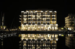 "Luxury building of hotel with reflection, Montenegro. TIVAT, MONTENEGRO – AUGUST 9th, 2015: Luxury building of hotel ""Regent"" with reflection at the night Royalty Free Stock Photo"
