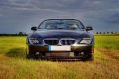 Luxury cabriolet in rural scene Royalty Free Stock Photography