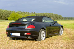 Luxury cabriolet in rural scene, backview Stock Photography