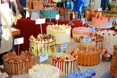 Luxury cakes for sale in on a market stall. Decorated luxury cakes for sale on a stall at a Victorian fair. Brightly coloured icing on the cakes. This was at stock photo