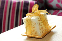 Luxury candle with gold ribbon detail Stock Images