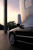 Luxury car. Elegant and luxury car amongst modern architecture Royalty Free Stock Photography
