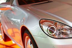 Luxury car. Details of  luxury car's headlight with colored reflections Royalty Free Stock Photo