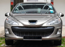 Luxury Car. A front facing photo taken on a metallic silver painted luxury car Royalty Free Stock Image