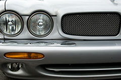 Luxury car. Front detail of silver luxury car royalty free stock photography