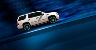 Luxury car. Luxury SUV car driving fast on blue motion background Stock Photography