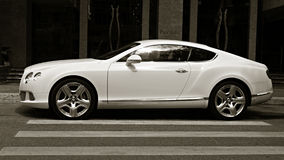 Luxury car Bentley Continental GT at the city street. Royalty Free Stock Photo