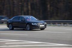 Luxury car black Audi speeding on empty highway royalty free stock photos