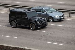 Luxury car black Mercedes  Benz G speeding on empty highway Royalty Free Stock Image