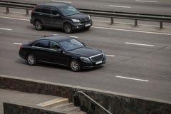 Luxury car black Mercedes  Benz  speeding on empty highway Stock Photo