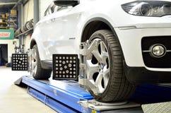 Luxury car BMW X6 on elevator inside car service Stock Images