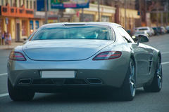Luxury car on the city street Royalty Free Stock Image