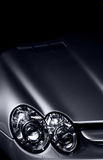 Luxury Car Detail Closeup. Closeup of the right headlight area of a luxury car. Color managed. Isolated against black background stock photo
