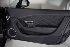 Luxury car door panel detail shot Royalty Free Stock Photos