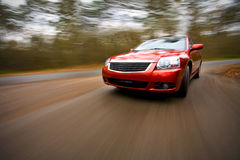 Luxury car driving fast Stock Photography