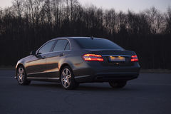 Luxury car on the evening road. 3/4 view no trademarks Stock Images