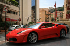 Luxury car Ferrari parked near store selling car Royalty Free Stock Photos