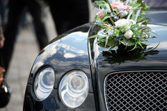 Luxury car with flowers. Front of the luxury car decorated flowers Stock Photo