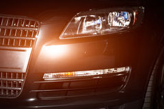 Luxury car front lights and grille closeup Stock Image
