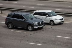 Luxury car grafit Mercedes  Benz GL speeding on empty highway Stock Images