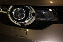 Luxury car headlight detail close-up Royalty Free Stock Photography