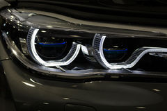 Luxury car headlight detail close-up Stock Photos