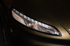 Luxury car headlight detail close-up Royalty Free Stock Photo