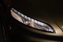 Luxury car headlight detail close-up Royalty Free Stock Photo