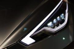 Luxury car headlight detail close-up Stock Image