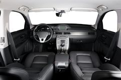 Luxury car inside. Interior of prestige modern car. Comfortable leather seats. Black leather cockpit with white background royalty free stock photo