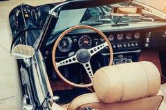 Luxury car interior. Beautiful retro style transport exhibition. Stock Photo