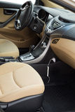 Luxury car interior. Close up. Black and beige color Royalty Free Stock Photography