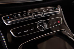 Luxury car interior details. Middle console with air and multimedia controls Stock Photography