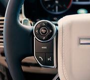 Luxury car interior: multimedia system control on the steering w Royalty Free Stock Image