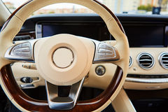 Luxury car Interior. Steering wheel and dashboard Royalty Free Stock Photography