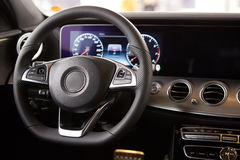 Luxury car Interior. Steering wheel and dashboard Royalty Free Stock Photo