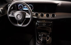 Luxury car Interior. Steering wheel and dashboard Royalty Free Stock Image