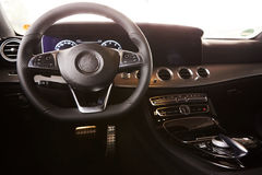 Luxury car Interior. Steering wheel and dashboard Royalty Free Stock Images
