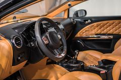 Luxury car Interior - steering wheel, shift lever and dashboard Stock Photo