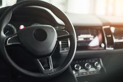 Luxury car Interior - steering wheel, shift lever and dashboard. Luxury car Interior - steering wheel, shift lever, dashboard and computer Royalty Free Stock Photography