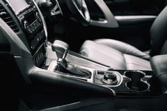 Luxury of car interior at transmission shift gear area. Modern c. Ar interior, gearstick radio and cup holder royalty free stock images