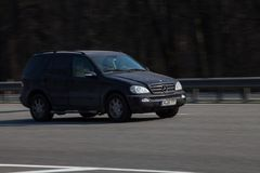 Luxury car Mercedes Benz speeding on empty highway royalty free stock images