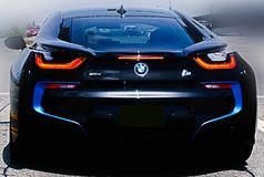 Luxury Car. One of BMW`s new cars and i8 with its gull wing doors on the road all dressed in black with blue features Royalty Free Stock Photography