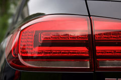 Luxury car rear light- closeup view Stock Photos
