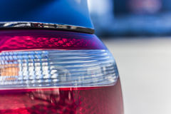 Luxury car rear light- closeup view. Background Royalty Free Stock Photo