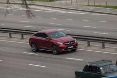 Luxury car red Mercedes  Benz GL speeding on empty highway Stock Photography