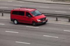 Luxury car red Mercedes Benz Viano speeding on empty highway stock photo