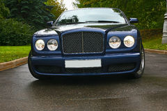 Luxury car on road Royalty Free Stock Image