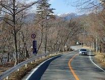 A luxury car running on mountain road in Takayama, Japan Royalty Free Stock Image